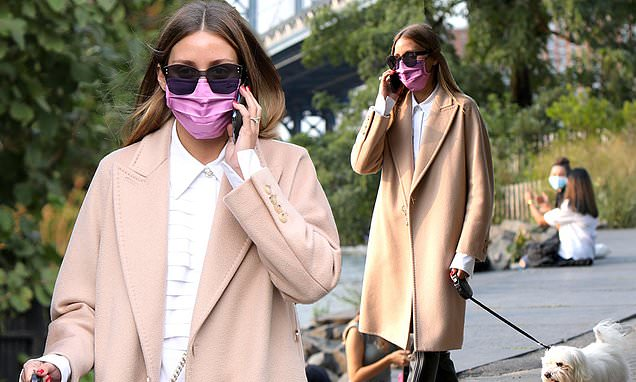 Olivia Palermo looks chic in a camel coat and leather thigh-high boots – Daily Mail