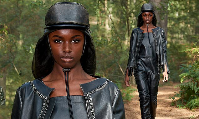 Leomie Anderson flaunts her model figure in black leather dungarees for Burberry – Daily Mail